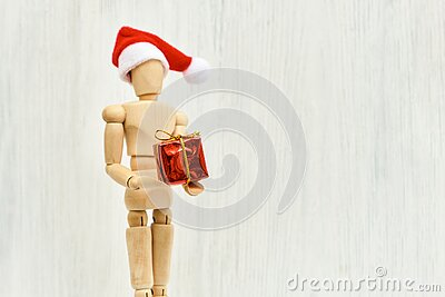 Wooden figure - art mannequin with red Santa hat with gift box