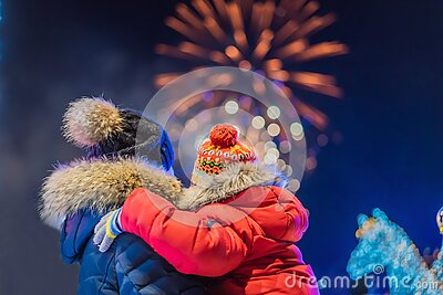 Happy family looking fireworks in the evening sky. fireworks new year, christmas