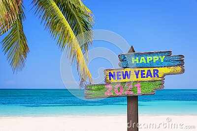 Hapy new year 2021 on a colored wooden direction signs beach and palm tree background
