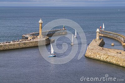 Sailing boats entering the harbour at Whitby