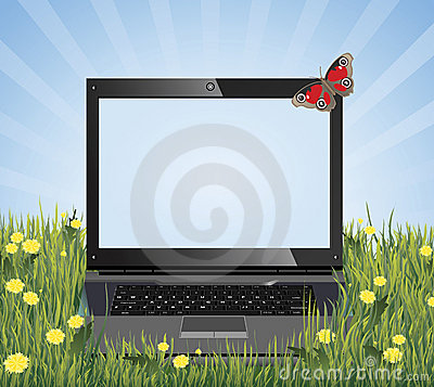 Laptop on the grass with place for text.