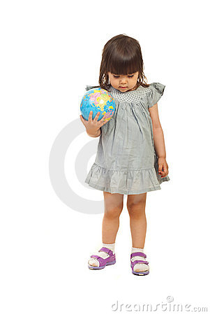 Toddler meditating and holding globe