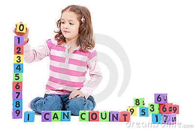 Girl counting numbers with kids blocks