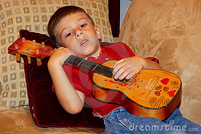 Child Playing a Ukulele