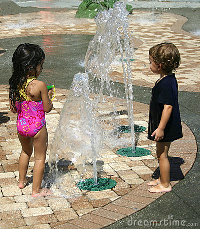 Boy and Girl playing in water pool