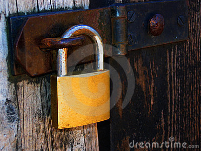 Padlock on wooden door