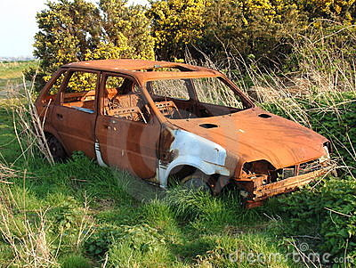 Abandoned rusty car wreck