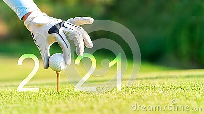 Golfer woman putting golf ball for Happy New Year 2021 on the green golf for new healthy.