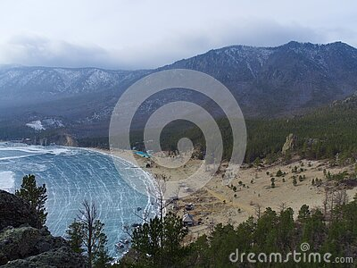 Top view from the cliff on the Bay of lake Baikal in winter