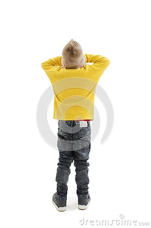 Back view of young boy confusing. Shocked little boy with hands on head. Noise, stress and people concept