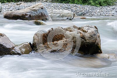 Rocky stream running water of mountain river