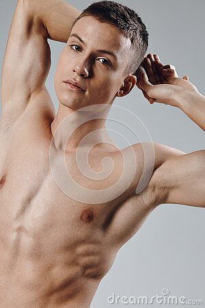 athletic physique young male nude torso gray background portrait
