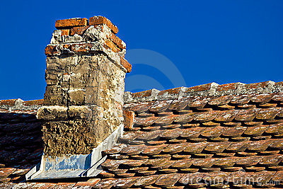 Old brick chimney and roof