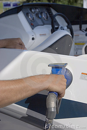 Man filling his boat with fuel at a gas station