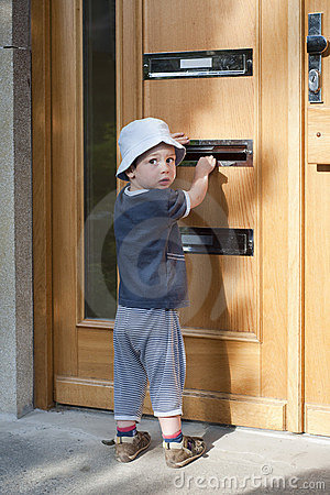 Child at door with letterbox