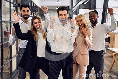 Group of young business people are working together in modern office they celebrate the victory, they won the tenter. Successful