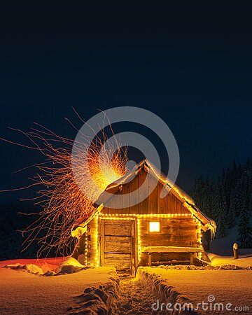 Fantastic landscape with glowing snowy house