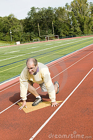 Senior man exercising sports field and run