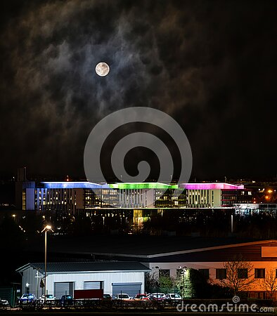 Mansfield town uk city skyline under full moon night sky industrial buildings houses and modern hospital panoramic high view