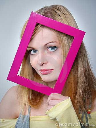 Girl with beautiful eyes holds a pink framework at