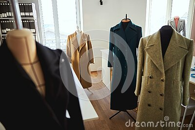 Vacant room filled with mannequins in coats