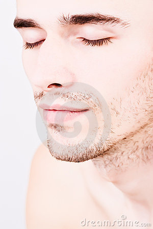 Closeup portraiture of handsome man closed eyes