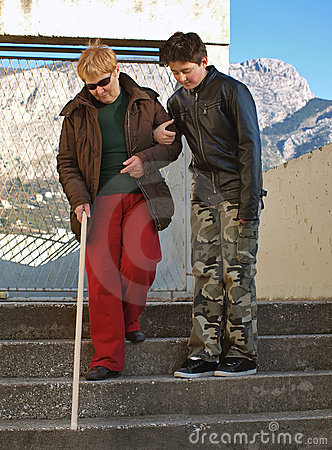 A teenager and a blind woman