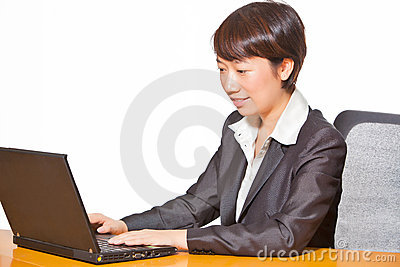 Beautiful business woman working on computer