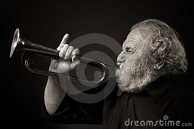 Old man blowing a bugle with gusto