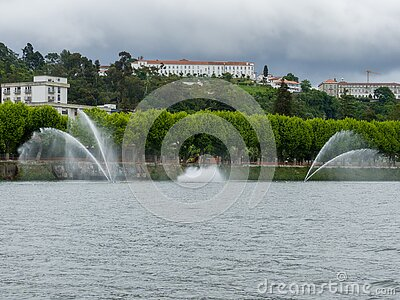 jets or fountains of water projected from the surface of the Mondego River in the city of Coimbra.