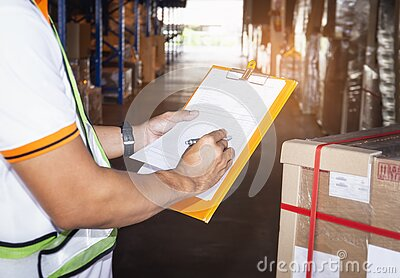 Warehouse worker holding clipboard his doing inventory management cargo boxes. Checking stock, Cargo shipment, Warehousing storage