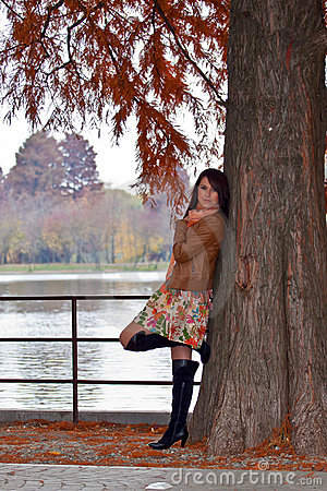 Sensual young woman waiting in park