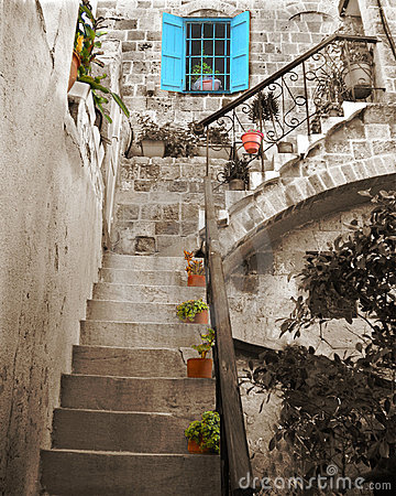 Old stone stairs and blue window