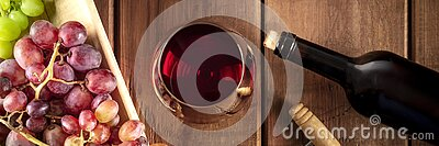 Wine Tasting Panorama. A red wine glass with a bottle, grapes, and a vintage corkscew