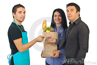 Couple and clerk at grocery