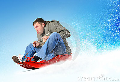 Young man flies on sled in the snow