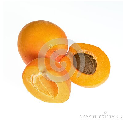 Ripe apricot fruits, one whole and one divided into several parts, on a white background in isolation
