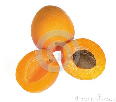 Ripe apricot fruits, one whole and divided into pieces, on a white background in isolation