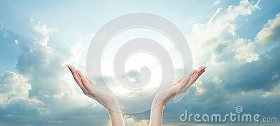 Hands reach for the sky in prayer