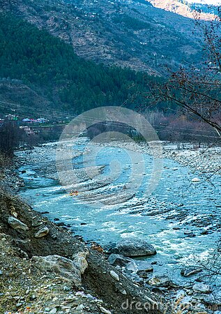 Rafting : boat moving on quiet  river section-river Beas . next to Kullu town in Himachal Pradesh