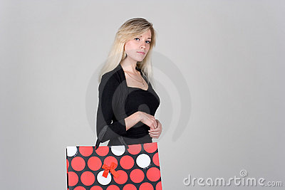 Young girl with shopping bag