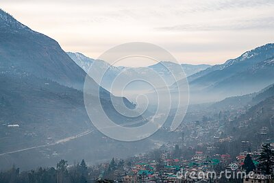 Valley of river Beas and town Kullu in foothiдды ща Himalayas- foggy