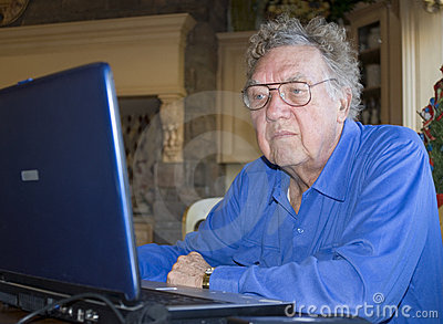 Senior citizen on computer