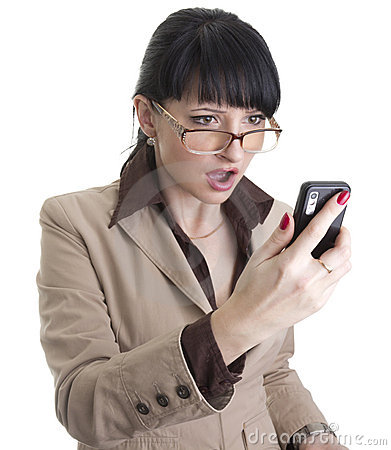 Frustrated business woman with cell phone