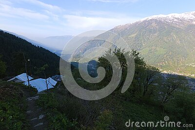 View of Kullu Valley and the mountains overlooking Manali town from camp site at Hamta, Himachal Pradesh, India