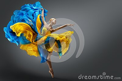Beautiful Woman Ballet Dancer Jumping in Air in Colorful Fluttering Dress. Graceful Ballerina Dancing in Yellow Blue Gown