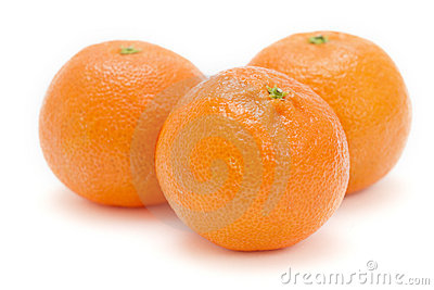 Three satsumas on white background