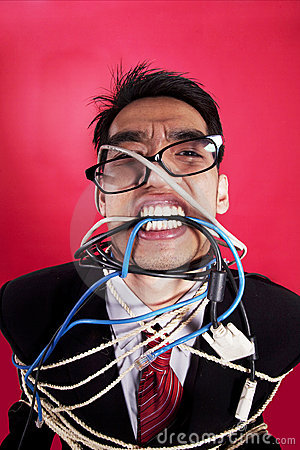 Mad businessman with cables