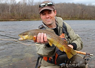 Fly fishing - fisherman holding fish (fish focus)