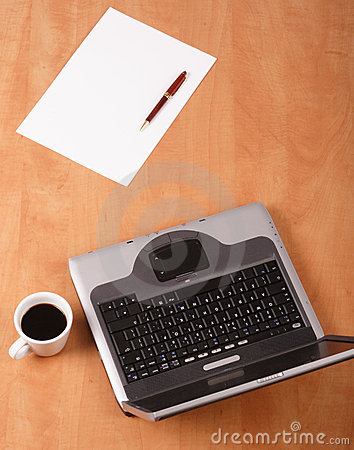 Blank paper, pen cup of coffee and laptop on the desk
